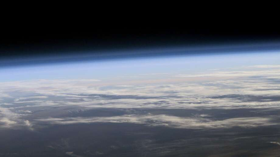 A view of Earth's atmosphere from space is shown. A new study finds that levels of ozone-destroying chlorine are declining, resulting in less ozone depletion. Photo: NASA