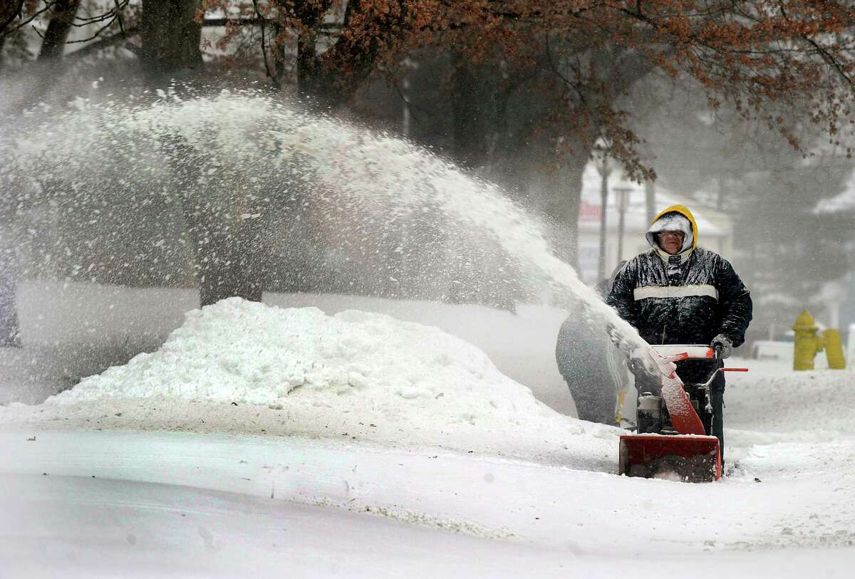 A man uses a snowblower on Locust Avenue in Danbury during Thursday's snowstorm, January 4, 2018.