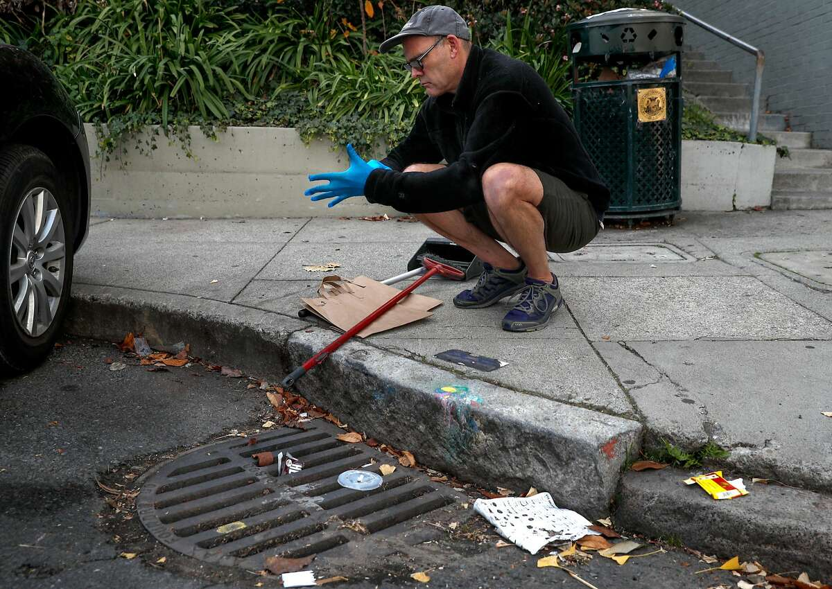 """A drain at the corner of Montgomery and Vallejo streets is just down the street from the drain Mark Cormier keeps clean to prevent clogging that leads to flooded streets near his Telegraph Hill home in San Francisco, Ca. as seen on Fri. December 22, 2017. The SFPUC is pushing to get folks to """"adopt"""" sewer drains in order to prevent flooding."""