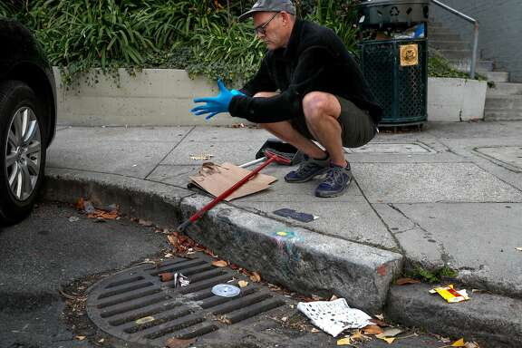 "A drain at the corner of Montgomery and Vallejo streets is just down the street from the drain Mark Cormier keeps clean to prevent clogging that leads to flooded streets near his Telegraph Hill home in San Francisco, Ca. as seen on Fri. December 22, 2017. The SFPUC is pushing to get folks to ""adopt"" sewer drains in order to prevent flooding."