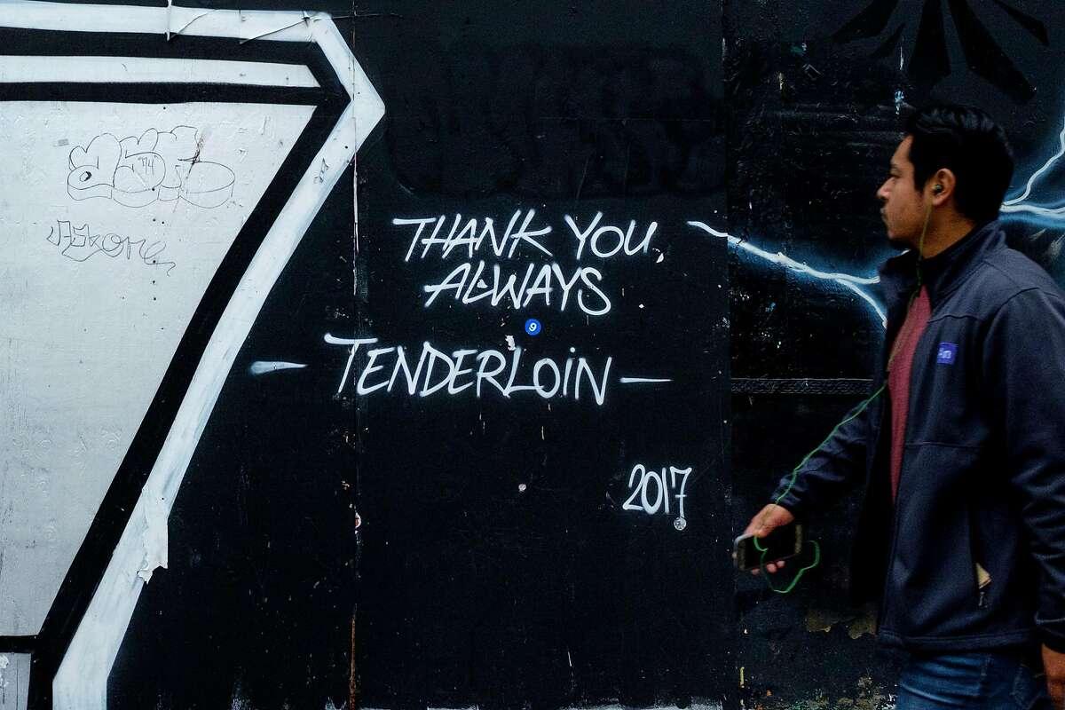 A man walks through the Tenderloin Neighborhood, Tuesday, Jan. 2, 2018, in San Francisco, Calif.