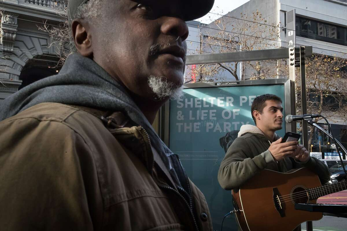 Singer Jamal Corrie, who was performing downtown, plays some keyboard music he performs to Robert Moses on Saturday, Dec. 30, 2017 in San Francisco, Calif. Moses of Robert Moses Kin is putting together The Bootstrap Project which will show street performers in February.