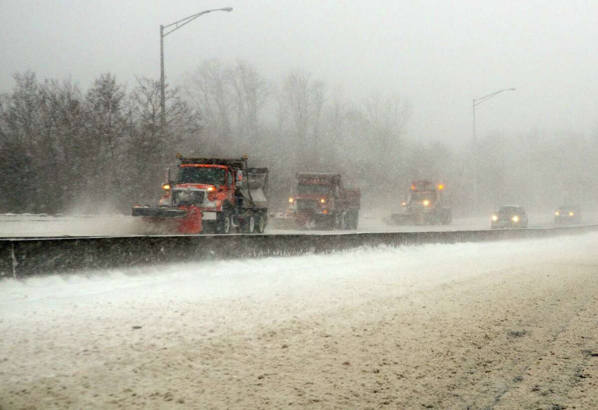 Plow trucks clear I95 northbound as a nor-easter hits Milford, Conn., on Thursday Jan. 4, 2018.