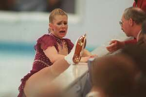 """Tonya Harding, of Portland Ore., shows her skate to the judges after interrupting her free skating program in this Feb. 25, 1994 photo at the Winter Olympics in Hamar, Norway. An attack on rival Nancy Kerrigan engineered by others, made her a hated person. """"I, Tonya,"""" a movie about her, reveals a more complex person."""