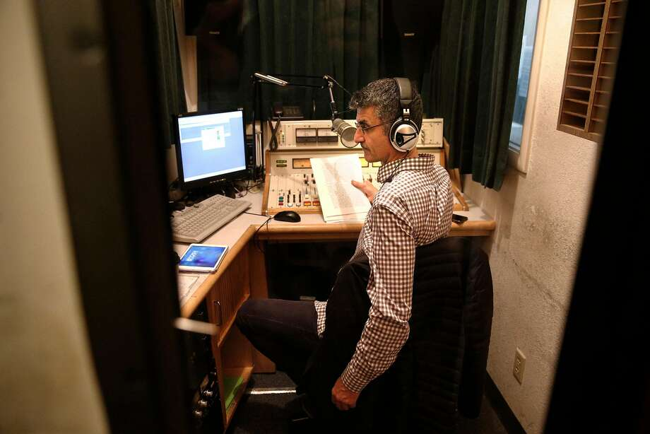 Shahram Aghamir, host of the Voices of the Middle East and North Africa program at KPFA radio in Berkeley, Ca., live on the air on Thurs. January 4, 2018. Photo: Michael Macor, The Chronicle
