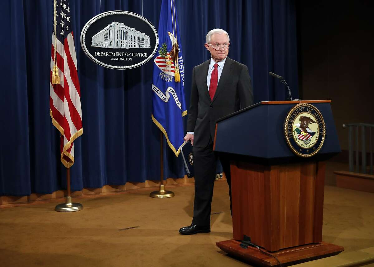 Attorney General Jeff Sessions walks from the podium at the conclusions of a news conference at the Justice Department in Washington, Friday, Dec. 15, 2017, about efforts to reduce violent crime. (AP Photo/Carolyn Kaster)