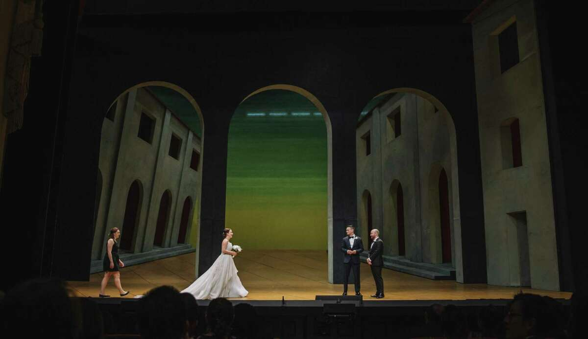 """Jessica Jacob and Zachary Townsend were married onstage at the War Memorial Opera House in San Francisco May 27, 2017, on a day where the Opera was holding a dress rehearsal for """"Rigoletto."""""""