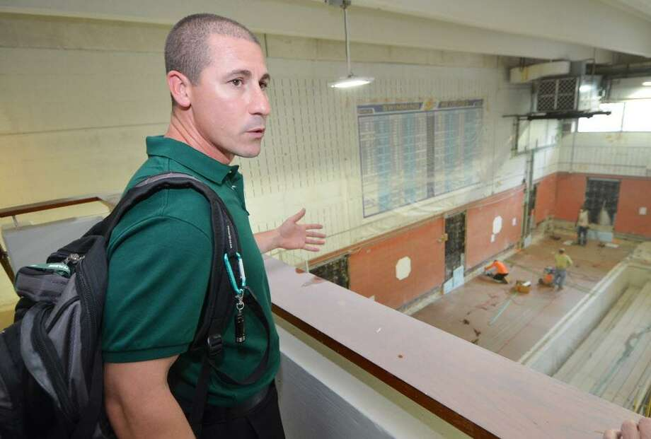 Norwalk boys swim coach Chris Passamano looks over construction on the pool at the Spinola Natatorium at Norwalk High School Aug. 31, 2016. Photo: Alex Von Kleydorff / Hearst Connecticut Media / Connecticut Post