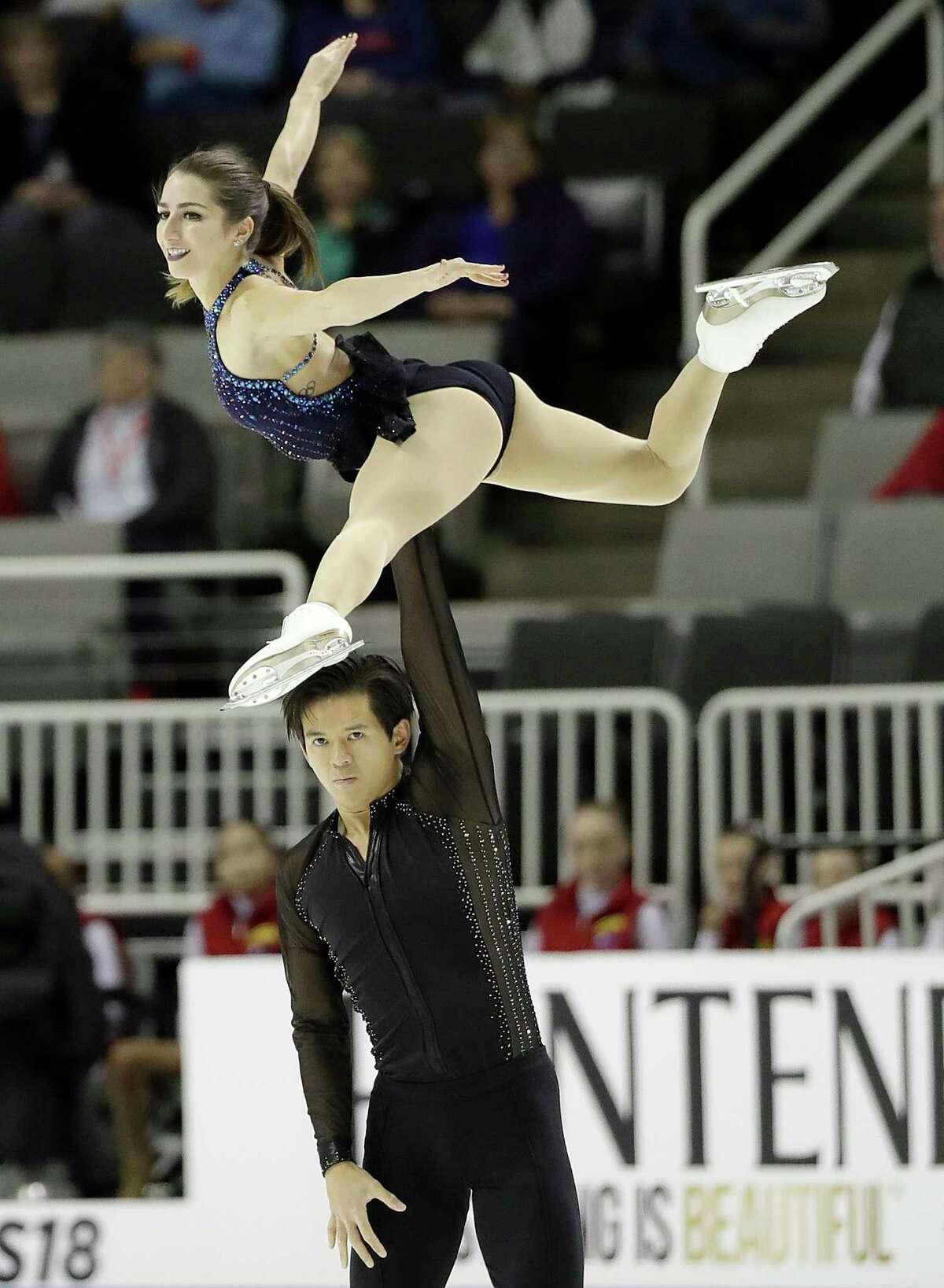 Marissa Castelli, top, and Mervin Tran perform during the pairs short program at the U.S. Figure Skating Championships in San Jose, Calif., Thursday, Jan. 4, 2018.
