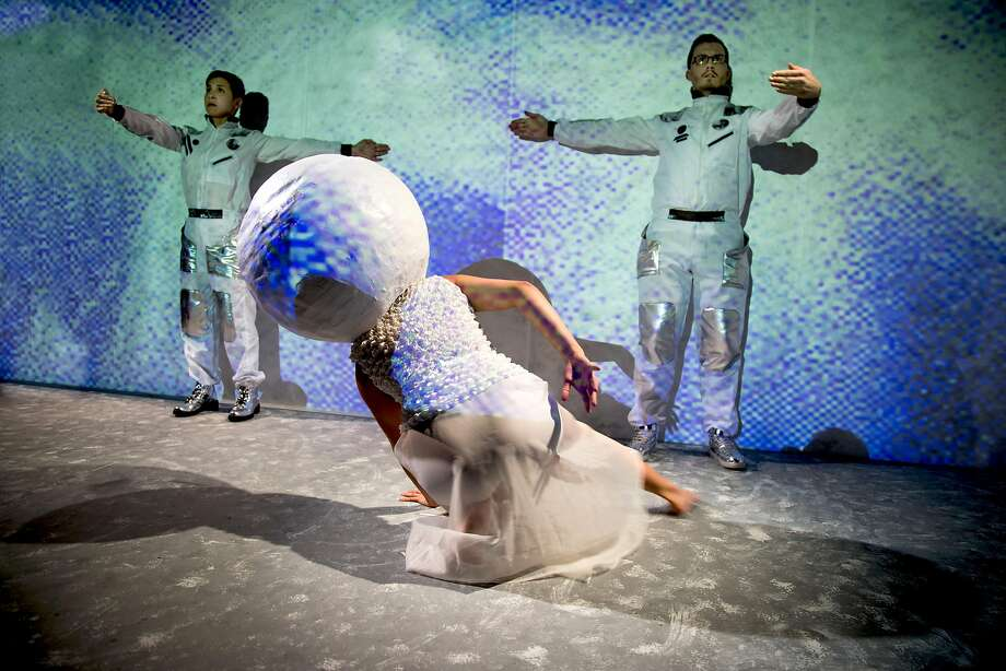 """The Moon (Isa Musni) meets the astronauts Stephanie DeMott (left) and Soren Santos in Mugwumpin's """"In Event of Moon Disaster"""" at Z Below in San Francisco. Photo: Battista Remati, Mugwumpin"""