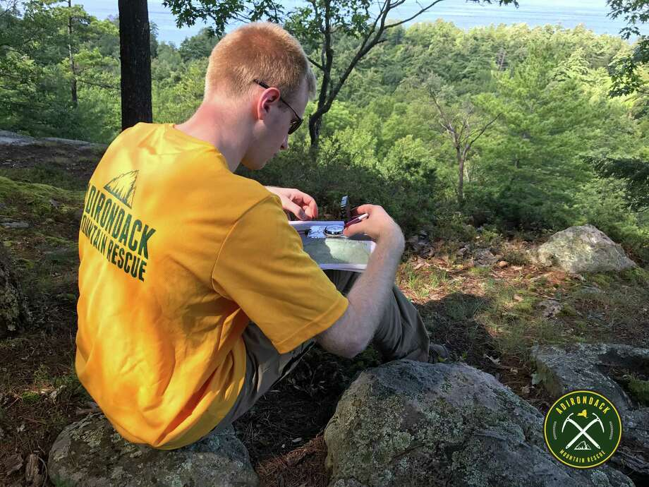 A member of Adirondack Mountain Rescue practices map and compass skills during a training session. (John Bulmer / Adirondack Mountain Rescue)