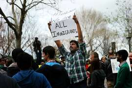 Muthumalla Dhandapani, an Indian immigrant with an H1-B visa and a Comcast employee in Sunnyvale, protests President Trump's immigration orders in 2017. A bill in Congress would� alter the employment-based immigrant system, tilting it towards immigrants from India and China, without increasing the overall number of visas for everyone.