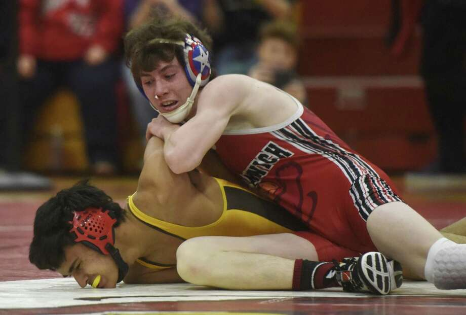 Greenwich's Mitchell Grimes, right, wrestles Brunswick's Rishi Das in the 113-pound bout of the high school wrestling match between Brunswick and Greenwich at Greenwich High School in Greenwich, Conn. Monday, Feb. 6, 2017. Grimes pinned Das, but Brunswick defeated Greenwich 45-19. Photo: Tyler Sizemore / Hearst Connecticut Media / Greenwich Time