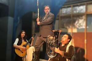 "From left:�Aldonza (Rachael Richman),�Miguel de Cervantes (Edward Hightower and a�trusty manservant (Dave Leon) in rehearsal for Custom Made Theatre Company's ""Man of La Mancha."""