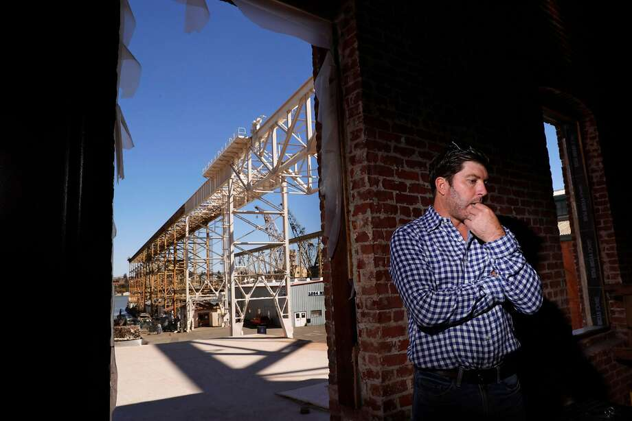 Dave Phinney, a Wine Country mogul, wants to redevelop 157 acres of waterfront on the former naval base Mare Island. He is shown here at Savage & Cooke, a distillery he recently opened on the old base's southern end. Photo: Carlos Avila Gonzalez / The Chronicle 2017