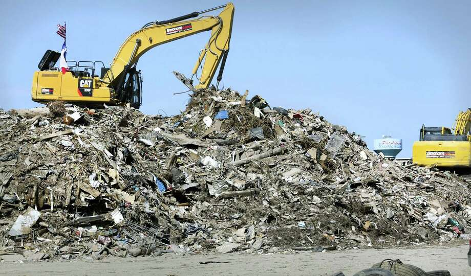 Large heap of trash from homes and businesses destroyed by Hurricane Harvey in Port Aransas is seen in this Oct. 24 photo. An $81 billion disaster-relief package for victims of Hurricane Harvey and other natural disasters is now likely to become part of the final negotiations for an all-inclusive 2018 spending bill. Photo: Bob Owen /San Antonio Express-News / ©2017 San Antonio Express-News