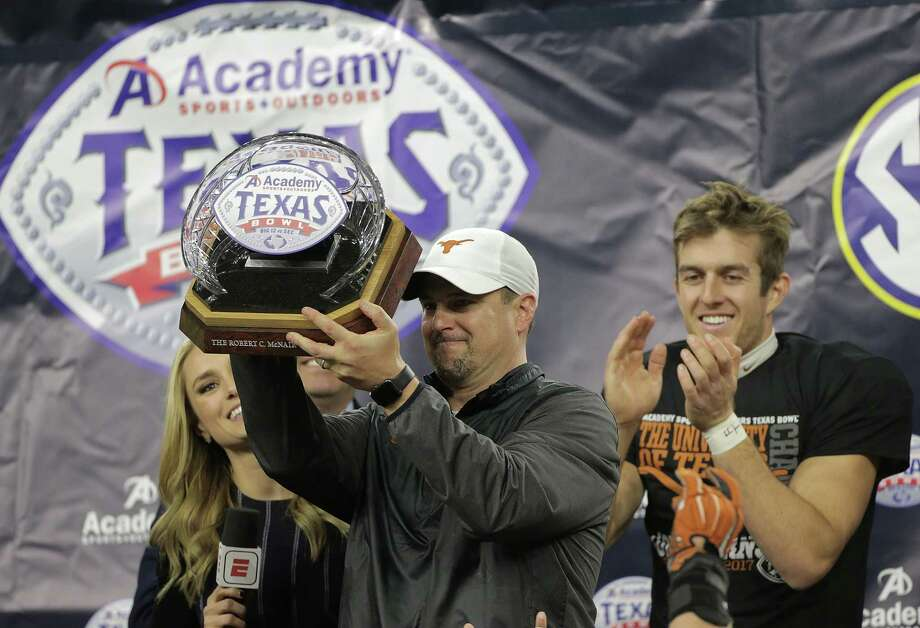 Tom Herman's first season at Texas got off to a rocky start with a home loss to Maryland but culminated with the Longhorns' coach hoisting a trophy after the Longhorns beat Missouri in the Academy Sports & Outdoors Texas Bowl. Photo: Elizabeth Conley, Chronicle / © 2017 Houston Chronicle