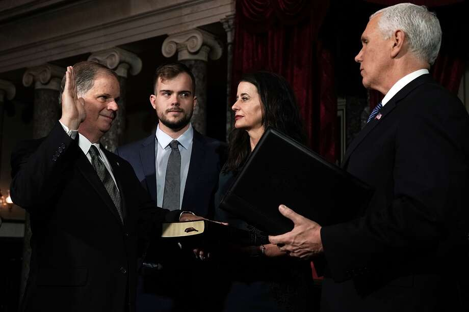 U.S. Sen. Doug Jones participates in a mock swearing-in ceremony with Vice President Mike Pence as Jones' wife Louise and son Carson look on at the Old Senate Chamber of the U.S. Capitol January 3, 2018 in Washington, DC. Click through the gallery for reactions to the photo. Photo: Alex Wong/Getty Images