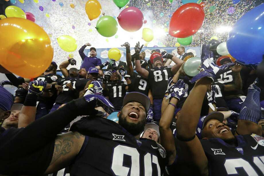 TCU players celebrate after defeating Stanford 39-37 in the Alamo Bowl Dec. 28 at the Alamodome. Photo: Edward A. Ornelas /San Antonio Express-News / © 2017 San Antonio Express-News