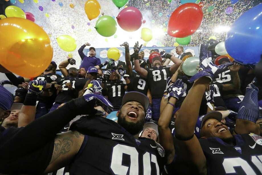 TCU players celebrate after defeating Stanford 39-37 in the Alamo Bowl Dec. 28 at the Alamodome. Photo: Edward A. Ornelas /San Antonio Express-News / © 2017 San Antonio Express-News
