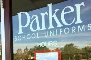 """A sign at the Parker School Uniforms on the corner of Bellaire and Braes boulevards said it was """"temporarily closed until further notice"""" on Thursday, Jan. 4, 2018."""