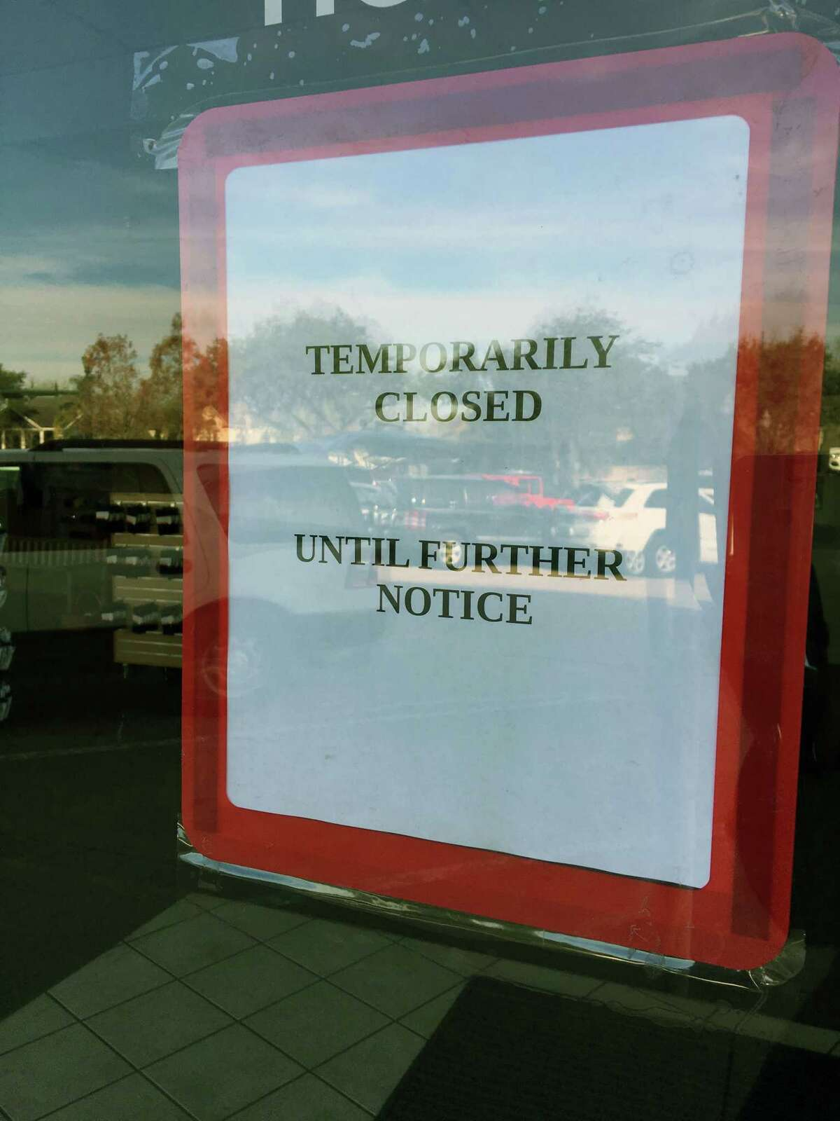 This sign was posted at the Bellaire and Braes location.