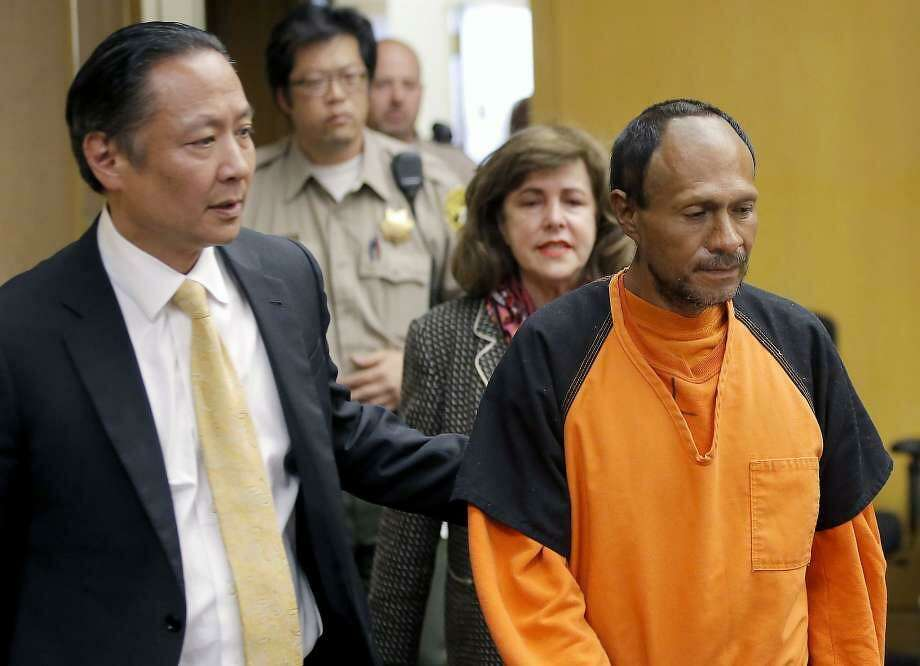 In this July 7, 2015 file photo, Jose Ines Garcia Zarate, right, is led into the courtroom by San Francisco Public Defender Jeff Adachi. Photo: Michael Macor, The Chronicle / /