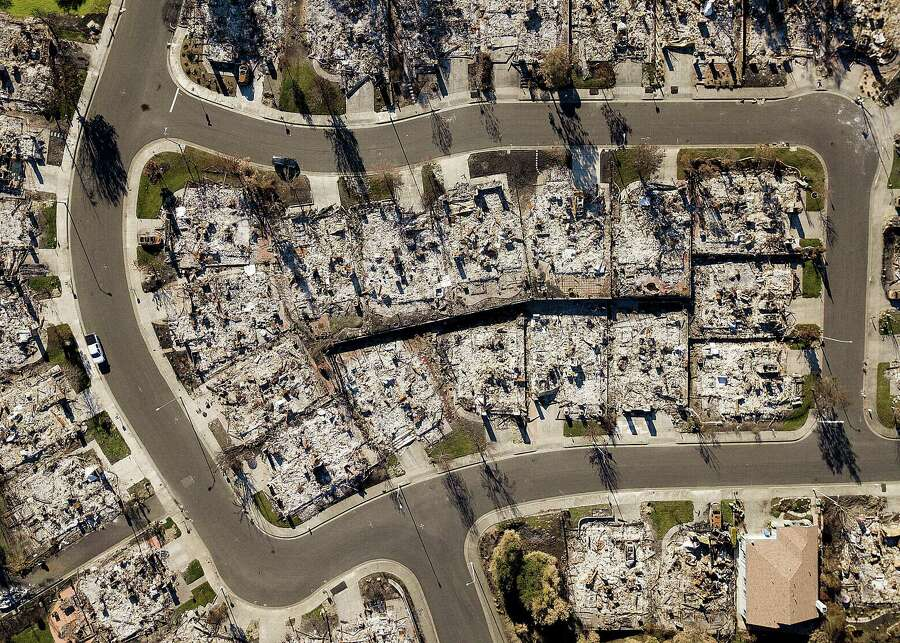 Homes leveled by the Tubbs fire line Bella Vista Way in Santa Rosa on Thursday, Dec. 21, 2017. The neighborhood lies across Fountaingrove Parkway from the proposed Round Barn Village development project that faces opposition amid concerns about future wildfires. Photo: Noah Berger / Special To The Chronicle / online_yes