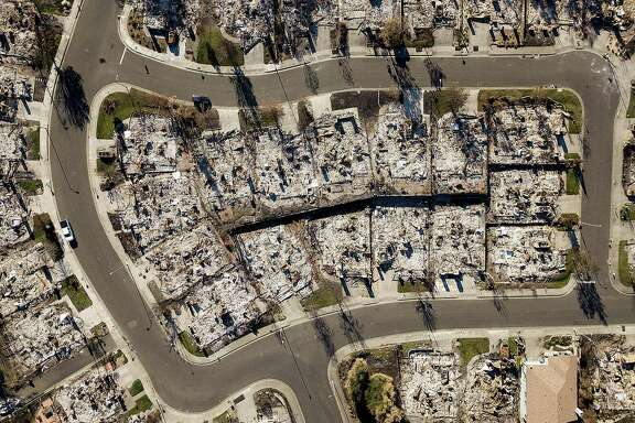 Homes leveled by the Tubbs fire line Bella Vista Way in Santa Rosa on Thursday, Dec. 21, 2017. The neighborhood lies across Fountaingrove Parkway from the proposed Round Barn Village development project that faces opposition amid concerns about future wildfires.