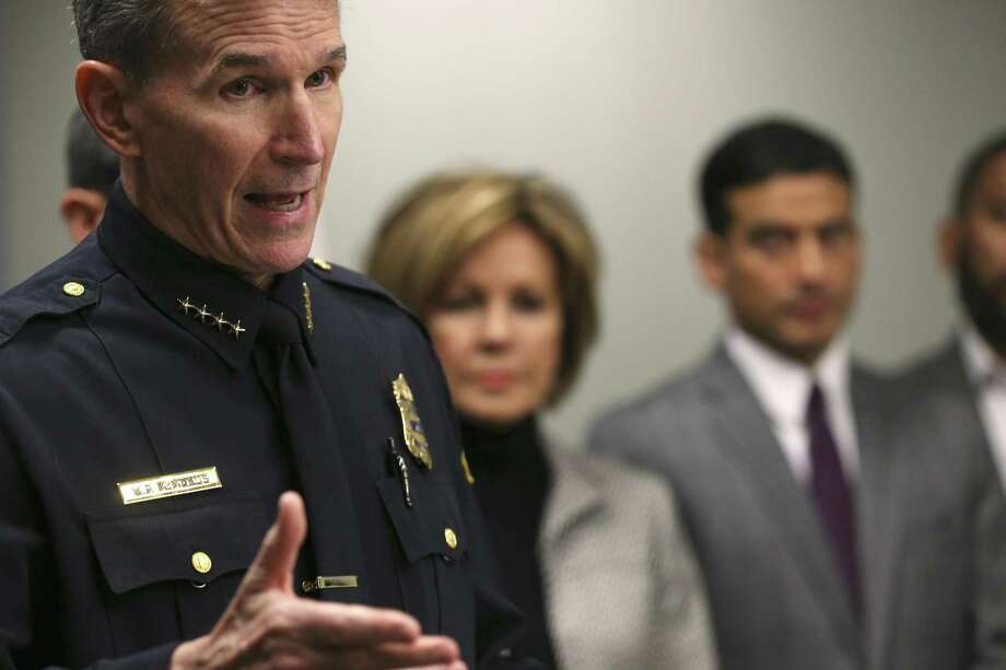 San Antonio Police Chief William McManus answers questions during a press conference announcing the Uniform Crime Report statistics, Thursday, Jan. 4, 2017. According to the report, the murder rate for San Antonio in 2017 dropped by 16-percent when compared to 2016. To the right are City Manager Sheryl Sculley and Bexar County District Attorney Nico LaHood. Photo: JERRY LARA / San Antonio Express-News / © 2018 San Antonio Express-News