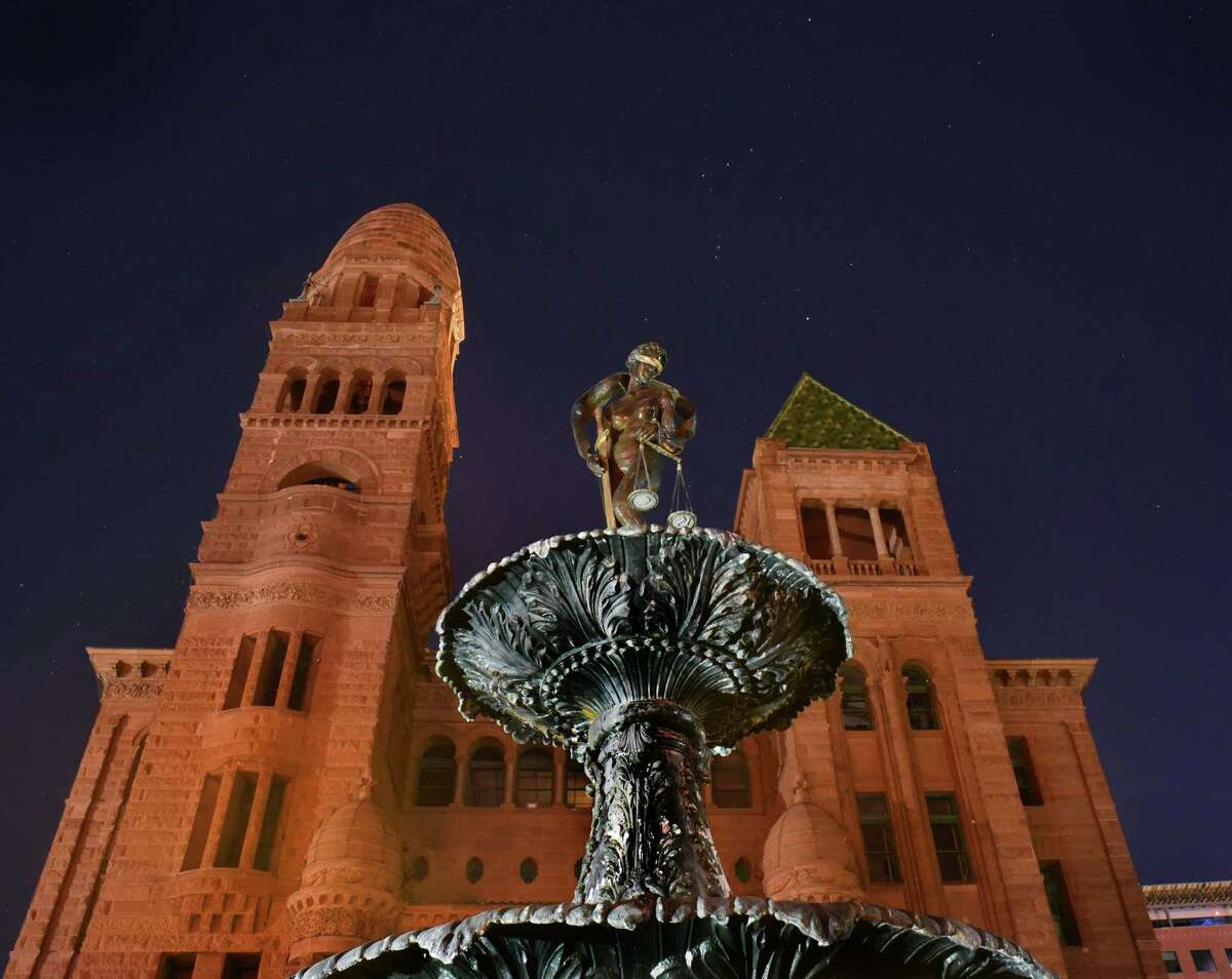 The Lady Justice statue atop a fountain in front of the old Bexar County Courthouse is being refurbished by the artist who created it, Gilbert E. Barrera. The constellation Orion is seen in the sky. Tuesday, Oct. 17, 2017.