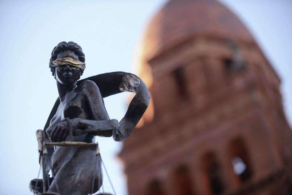 The Lady Justice statue in front of the old red Bexar County Courthouse was put there in 2008. It was made by artist Gilbert E. Barrera. Tuesday, Oct. 17, 2017.