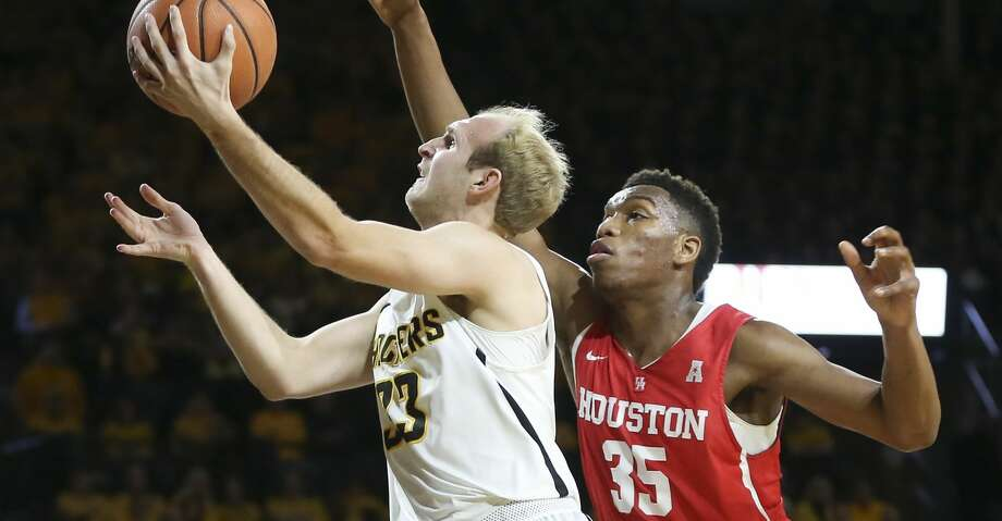 Wichita State guard Conner Frankamp goes to the basket against Houston forward Fabian White Jr. during the first half of an NCAA college basketball game in Wichita, Kan., Thursday, Jan. 4, 2018. (Travis Heying/The Wichita Eagle via AP) Photo: Travis Heying/Associated Press