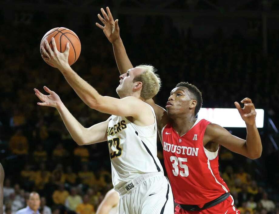 Wichita State guard Conner Frankamp goes to the basket against Houston forward Fabian White Jr. during the first half of an NCAA college basketball game in Wichita, Kan., Thursday, Jan. 4, 2018. (Travis Heying/The Wichita Eagle via AP) Photo: Travis Heying, MBO / The Wichita Eagle