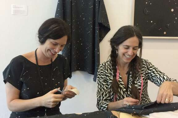 Lena Wolff (left) and Erica Tanov work on a clothing collection based on a collage Wolff created for the de Young.