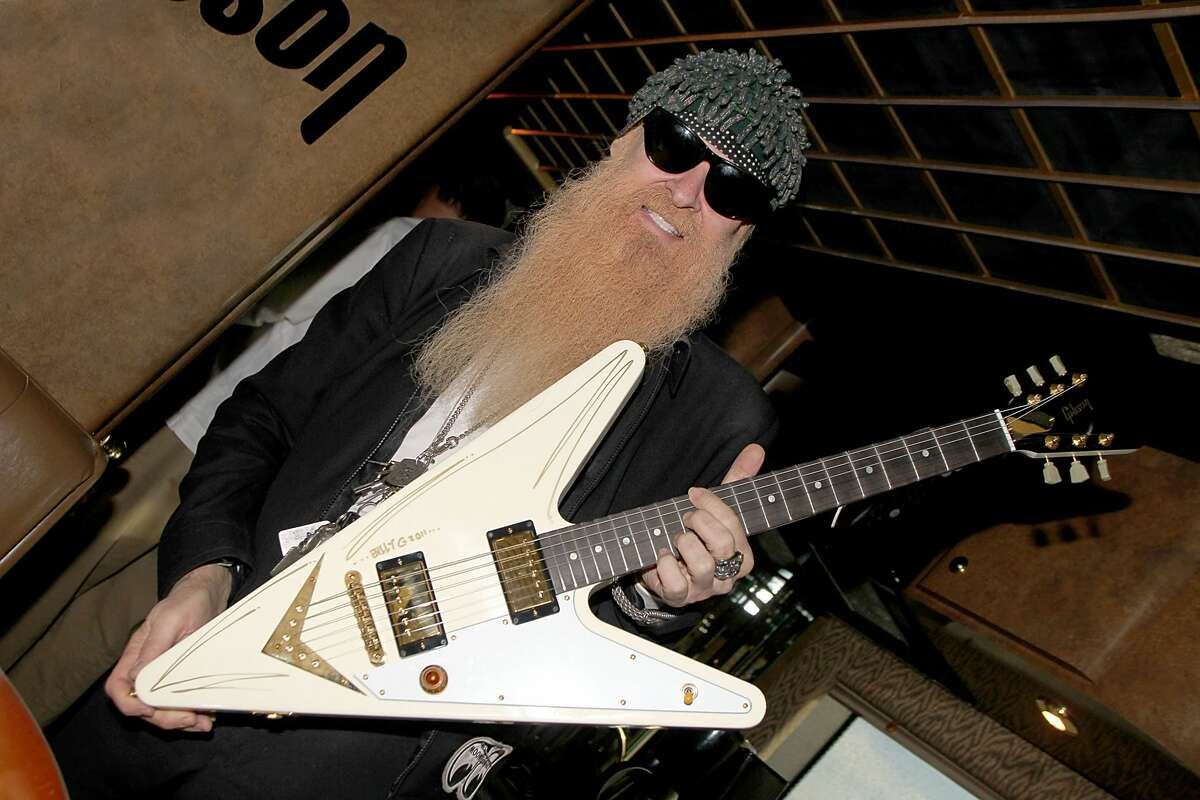 Musician/vocalist Billy Gibbons of ZZ Top signs a Gibson Reverse Flying V on the Gibson Guitars bus on Jan. 28, 2011 in San Antonio, Texas.
