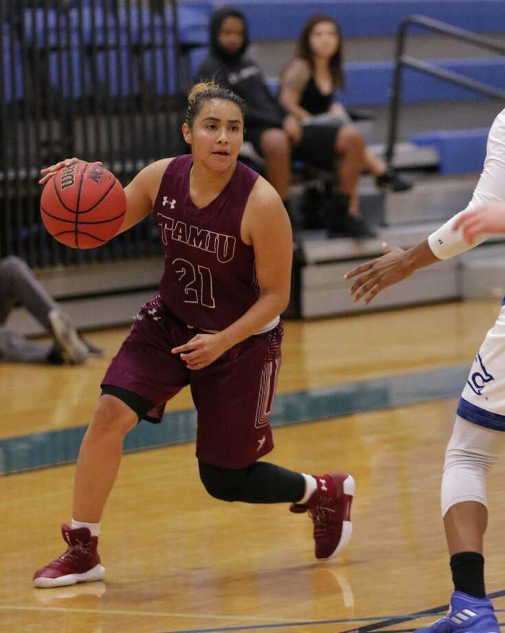TAMIU point guard Ashley Perez had 14 points and a career-high 11 assists Saturday in a 71-64 loss at third-place St. Mary's. The Dustdevils head to the Heartland Conference Tournament next week against the league champion in No. 2 Lubbock Christian. Photo: Clara Sandoval / Laredo Morning Times File