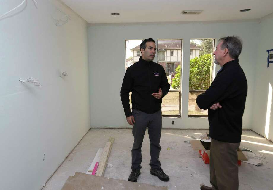 Commissioner of the Texas General Land Office George P. Bush talks to homeowner Scott Short, 66, while walking through Short's Hurricane Harvey flooded house on Chalmette Street on Thursday, Jan. 4, 2018, in League City. Short, who has been living in his house for 22 year, is renovating his flooded house and has received a FEMA RV about two weeks ago. ( Yi-Chin Lee / Houston Chronicle ) Photo: Yi-Chin Lee, Houston Chronicle / © 2018  Houston Chronicle