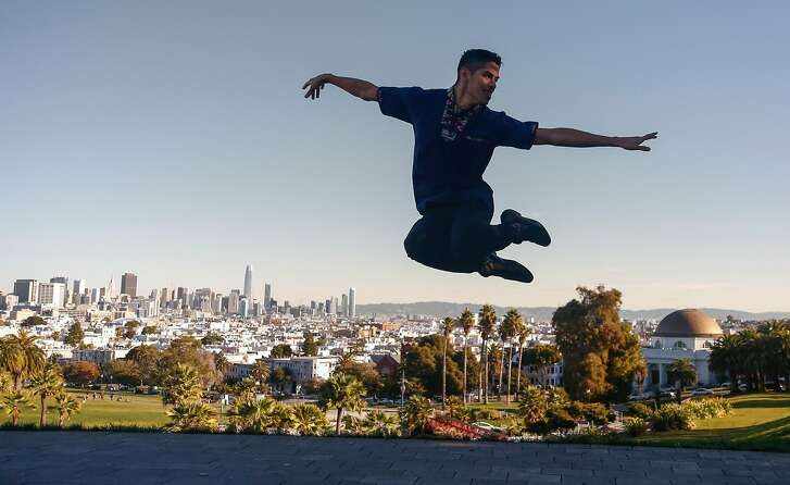 Gabriel Mata demonstrates his dance skills at Dolores Park during a portrait session on Wednesday December 20th, 2017.
