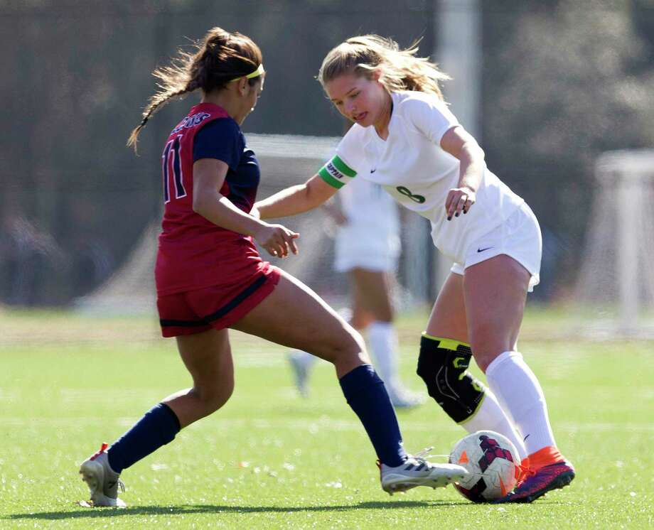 The Woodlands midfielder Addie Gordy (8) controls the ball as Katy Tompkins defenseman Valeria Gomez (11) defends in the second period of a match during the Highlander Invitational at Gosling Sports Complex, Thursday, Jan. 4, 2018, in Photo: Jason Fochtman, Staff Photographer / © 2017 Houston Chronicle
