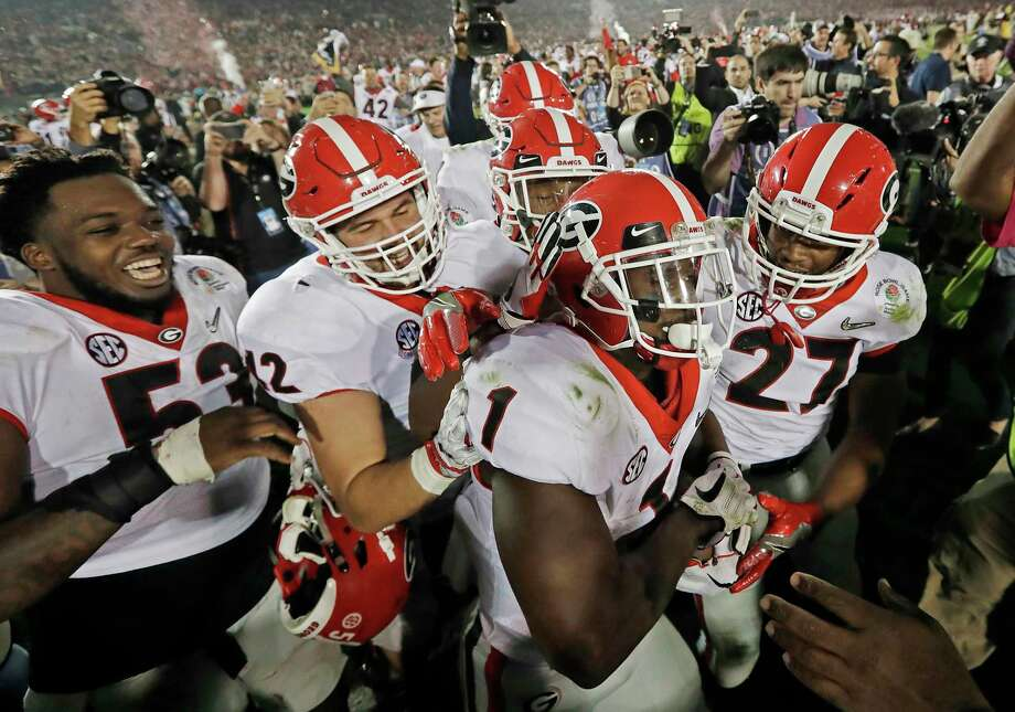 FILE - In this Monday, Jan. 1, 2018, file photo ,Georgia tailback Sony Michel (1) celebrates with teammates after scoring the game-winning touchdown in the second overtime period to give Georgia a 54-48 win over Oklahoma in the Rose Bowl NCAA college football game in Pasadena, Calif. Georgia coach Kirby Smart is concerned the emotional drain from the Rose Bowl playoff semifinal win over Oklahoma could affect his team's ability to regroup for the national championship game against Alabama.  (AP Photo/Doug Benc, File) Photo: Doug Benc / Copyright 2018 The Associated Press. All rights reserved.