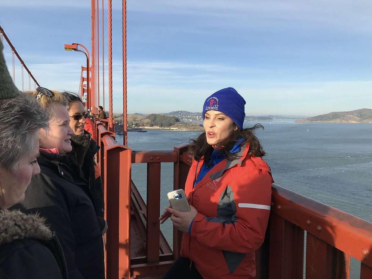 Bridgewatch founder Mia Munayer with volunteers on the Golden Gate Bridge.