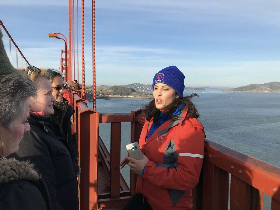 Bridgewatch founder Mia Munayer with volunteers on the Golden Gate Bridge. Photo: Beth Spotswood