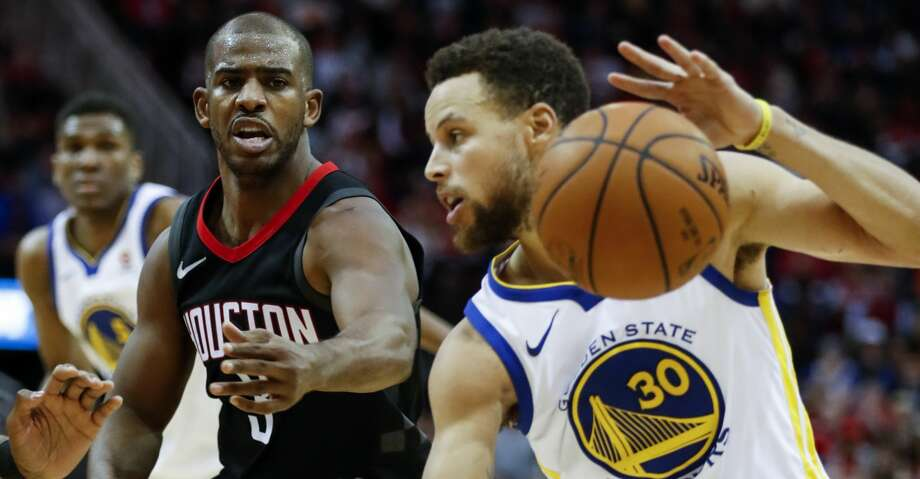 Houston Rockets Guard Chris Paul  Defends Against Golden State Warriors Guard Stephen Curry