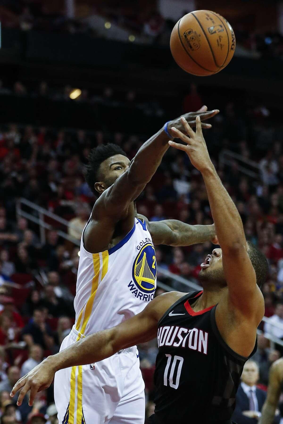 Golden State Warriors forward Jordan Bell (2) blocks a shot by Houston Rockets guard Eric Gordon (10) during the third quarter of an NBA basketball game at Toyota Center on Thursday, Jan. 4, 2018, in Houston. ( Brett Coomer / Houston Chronicle )