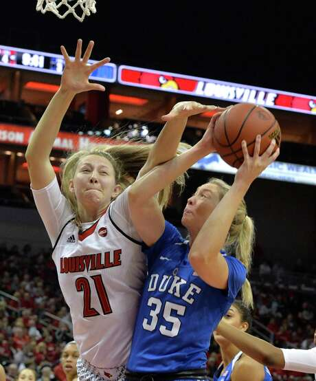 Louisville's Kylee Shook, left, attempts to block a shot by Duke's Erin Mathias during Thursday's game. No. 3 Louisville held off No. 17 Duke 66-60. Photo: Timothy D. Easley, FRE / FR43398 AP