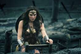"""This image released by Warner Bros. Entertainment shows Gal Gadot emerging from a trench during a WWI battle scene in """"Wonder Woman."""" (Clay Enos/Warner Bros. Entertainment via AP)"""