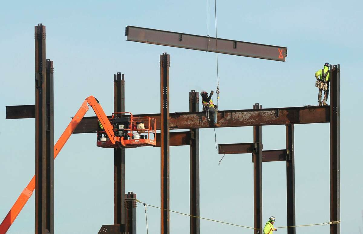 Steel workers move beams into place at The Sono Collection development on Wednesday, January 3, 2018, in Norwalk, Conn. Construction was among the sectors leading U.S. job gains in December, according to a Friday report from the Department of Labor.