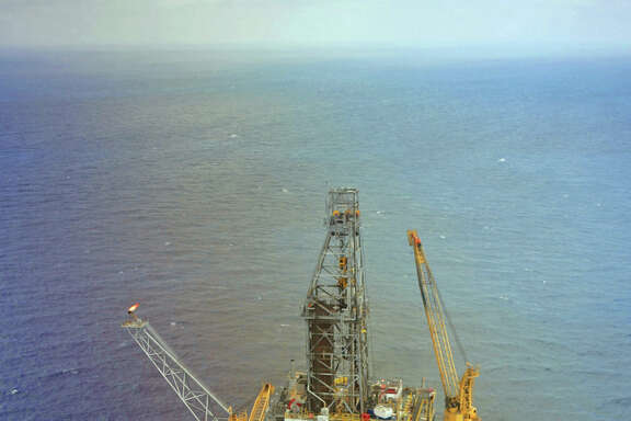 Mad Dog platform aerial in the Gulf of Mexico.  Located in 4,500 feet of water some 190 miles south of New Orleans, Mad Dog has the capacity to produce up to 80,000 barrels of oil and 40 million cubic feet of natural gas per day.