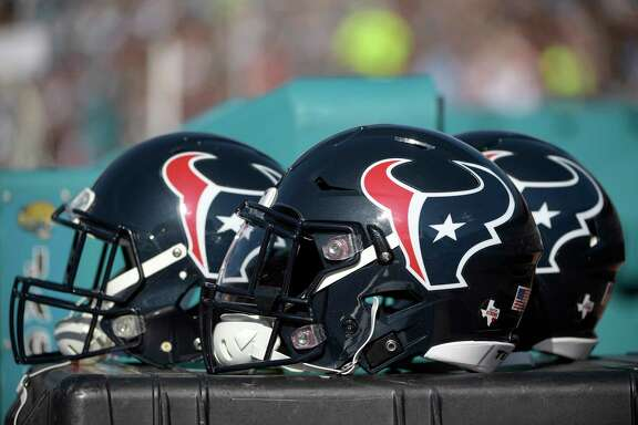 Houston Texans helmets sit behind the bench during the second half of an NFL football game against the Jacksonville Jaguars Sunday, Dec. 17, 2017, in Jacksonville, Fla. The Jaguars won 45-7. (AP Photo/Phelan M. Ebenhack)